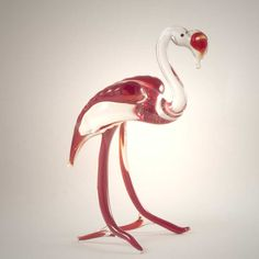 Blown Glass Flamingo Figure is a hand-blown art glass figurine which is created by Russian artists in art studio in St.Petersburg. This figurine is made in technique of lampworking using color glass.