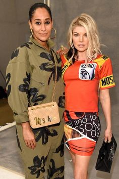 New Trending Celebrity Looks: Tracee Ellis Ross and Fergie Team Up Briefly at the Moschino Fashion Show. We just adore the sorts of random celebrity pairups that can only happen when you shove as much of them as you can fit in the front row of a fashion show. Just look at these two:  It's like they each have no idea how to act around the other one. Although we suppose their ensembles might...