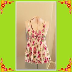 Rose design tunic Such a cute top!  Pretty pink roses with green leaves set against a white background. Skinny straps. The style is a short tunic. Voice Tops Tunics