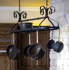 Black Ornamental Oval Pot Rack with Scrolled Metal Detail