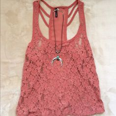 Sheer salmon colored tank with back detail Sheer salmon colored tank. Beautiful back detail and floral lacey material. Size small. Pre-loved, but in good condition! Tops Tank Tops
