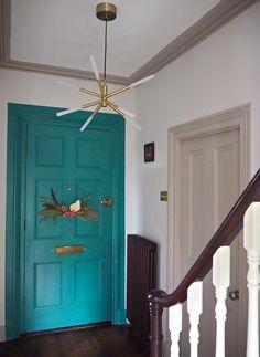 Hallway decor ideas and inspiration. Modern hallway in bold colours. Painted doors and woodwork in grey. Teal Door, Turquoise Door, Bright Hallway, Modern Hallway, Wooden Sash Windows, Make A Door, Picture Shelves, Small Hallways, Paint Brands