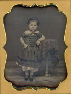 Sassy Girl.  Daguerreotype1/4 Plate daguerreotype of a sassy looking little girl posed with her arm on a camera stand.