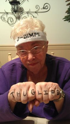 Thug Life Granny. This lady is so hood! Gangsta's rollin'