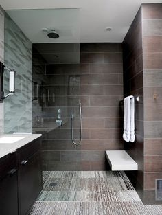 Wood tiles, contemporary open rain shower, glass panel,
