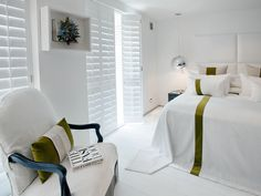 Designer Kelly Hoppen outfitted her London bedroom with her own line of Plantation shutters. So clean, so tailored.