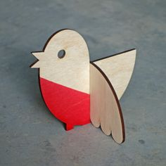 Lisa Jones Ornamental Christmas Robin: This little Robin makes the perfect festive ornament. Designed by Lisa Jones and made from sustainable birch ply wood with a hand dipped red breast. Please note this item is made from natural materials so some differences may occur. Lisa Jones and her partner Edward begin designing cards in 2000 in their London studio. Both from Fashion and Design backgrounds they have worked for and supplied their wares to clients all over the world such as The V&A…