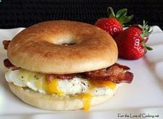 Eggs over easy with bacon, home fries, cheese, salt, pepper,  ketchup on a bagel. :o)