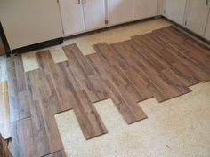 """How to Lay Laminate Flooring in One Day: Lay Planks Out """"Dry"""" First"""