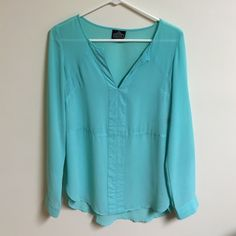 Teal Blouse Sleeves are long, but have a button half way up to make them quarter sleeves if you want. The bottom opens up and makes it a little flowy! Some very mild snags - you only notice them if you're looking for them. Picture shown. Angie Tops Blouses
