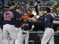 Boston Red Sox batter Shane Victorino, right, celebrates with Will Middlebrooks after Victorino hit a two-run home run during the eighth inning of a baseball game against the New York Yankees, Friday, Sept. 6, 2013, at Yankee Stadium in New York. (AP Photo/Bill Kostroun)
