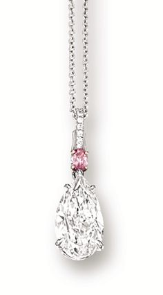 DIAMOND AND PINK DIAMOND PENDANT NECKLACE. Suspending on a pear-shaped diamond weighing 5.02 carats, surmounted by an oval pink diamond, accompanied by a white gold link-chain, mounted in platinum and 18 karat pink gold, length approximately 400mm.