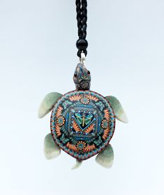 My favorite polymer clay cane maker -Jon Anderson.   Spiritwear Sea Turtle