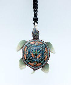 My favorite polymer clay cane maker -Jon Anderson.   Spiritwear Sea Turtle