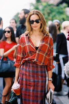Wow...I'd never dare to mix plaids, but this works somehow...except that she could look a little less skeptical of the look herself!