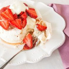 Meringues with champagne poached strawberries and vanilla cream - the perfect anniversary celebration.