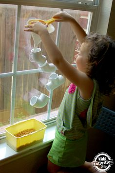 Has your child experimented with tube play? If you are desperate for a couple of hours of peace you will *love* this activity!!