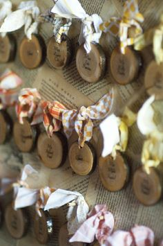 escort cards on slices of wood - tie to board backed by music paper bordered in burlap. tie to board with white, ivory and light pink lace