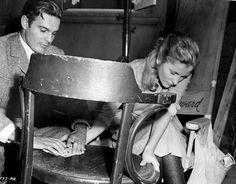 Louis Jourdan and Joan Fontaine pass the time between takes of Letter from an Unknown Woman Tags: 1947, break, cards, Joan Fontaine, Letter from an Unknown Woman, Louis Jourdan, Take a Break,