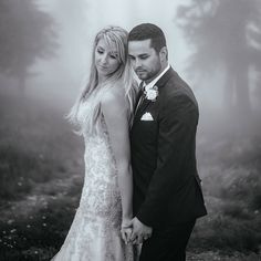 Bride and Groom just married on top of Schweitzer Mountain romantic sexy black and white wedding day portrait surrounded by thick fog and trees photo by matt Shumate Photography
