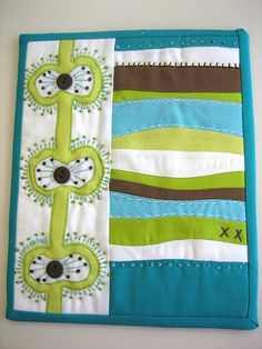 super cute art quilts. These would be fun to make. :)