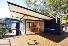 Warm and welcoming ... floor-to-ceiling glazing has been used in all north facing rooms of this Avoca Beach ''shack'', while inside blackbuttis a feature.