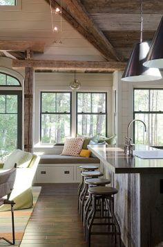 windows, bar stools, dark floor, plank walls, beams