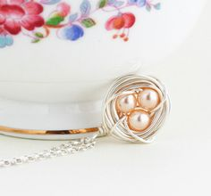 A personal favorite from my Etsy shop https://www.etsy.com/ca/listing/119783553/silver-bird-nest-necklace-with-peach