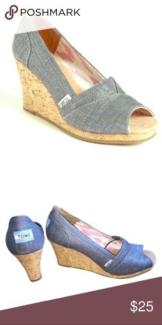 Toms Denim Chambray Metallic Wedges Great condition cork wedges with a denim/chambray metallic peep toe fabric. Pretty pink and white ikat lining. Great condition!   Wore these during my pregnancy last spring but they aren't working for chasing a baby around this spring.   They match with so much and are really comfy despite the height.   True to size and true to Toms sizing. Toms Shoes Wedges