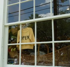 Who needs a paper 'Open' sign when you have a knit sweater to hang in the window?