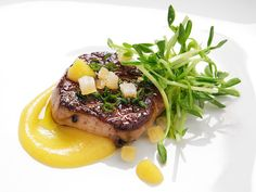 Seared foie gras with a creamy spiced orange puree and candied orange zest.
