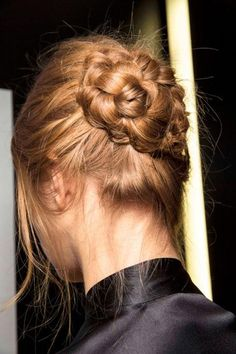 Wind a braided pony into a chunky bun.