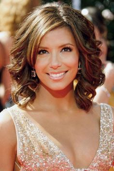 Google Image Result for http://free.bridal-shower-themes.com/img/cute-hairstyles-for-medium-curly-hair-with-side-bangs_1.jpg