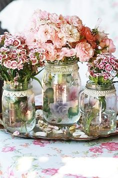 Pink vintage flowers in a glass jar....sweet williams & pinks.