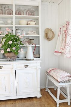I love this white hutch with the red and white accents.