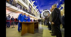 NASA Astronaut Scott Kelly and Russian cosmonauts Gennady Padalka and Mikhail Kornienko report to senior officials before their second day of qualification exams at the Gagarin Cosmonaut Training Center in Star City, Russia, on March 4.