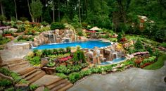 Inspirational: Poolside landscaping with hot tub, waterfalls, patios, stone steps and flowers.
