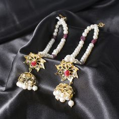#Hyderabadi #Nizam #Karanphool - They are flower shaped #Kundan #earrings made from #gemstones and #pearls. A 2 strand #pearl is attached to the earring that is hooked in the hair when the earring is worn, completing a royal look. Choice of pearls like cream, off white, etc., semi precious stones like #emerald, #turquoise, etc. and slight variation in style available. For custom orders please contact 408-800-7134