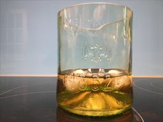 Glass tumbler, whisky, gin water tumbler made from a Bacardi bottle.   Love these Bacardi bottle glasses.  A subtle green and some pretty cool embossed features.