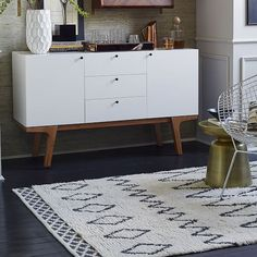 I love this rug! Rugs can tie a room together as well as create separate spaces.