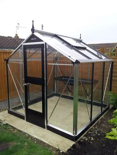A Juliana Compact greenhouse built by one of our expert fitters
