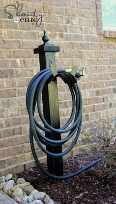 Garden Hose Holder for the backyard (get a concrete fence post holder and bury that in the play area woodchips instead of having to stake a post into the ground)