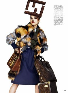 "Crystal Renn in ""Mi Vida Logo"" by Giampaolo Sgura for Vogue Japan December 2012"