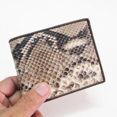 Hit Hot (Genuine) Python Skin Leather Bifold White & Black Wallet(SNAKE SKIN IS NATURAL, IT MAY DIFFERENT FROM THE PHOTO) by HitHot. $26.99. THE BEST LEATHER WALLETS & HIGH QUALITY  ** GENUINE  Python Skin **  HIGH CLASS !!!  Python  !!! SKIN LEATHER BIFOLD WALLET,FOR YOU(SNAKE SKIN IS NATURAL, IT MAY DIFFERENT FROM THE PHOTO). Save 21% Off!