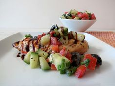 Mediterranean Grilled Chicken  - The most tender flavorful grilled chicken topped with a tomato and cucumber salsa.