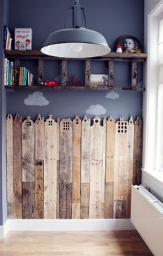 I like the idea of the wood like fence.  You could have one pannel for every child in your classroom and then use it as a growth chart for toddlers.  When the child moves up or leaves the centre you can give it to the parents.  Use Pallet wood. by soulouttaki