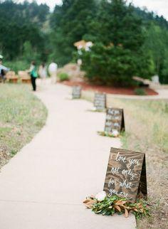 rustic wedding walkway with wedding sign decor