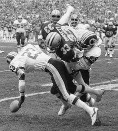 In this Jan. 22, 1983, file photo, the Cowboys' Tony Dorsett takes a hard hit and fumbles the ball in first quarter against the Redskins in Washington.