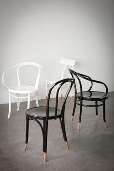 Clockwise from front: Thonet No.18, Le Corbusier (white), Hermann Chair, Le Corbusier (black), all painted with natural socks. Photo; www.mikeclare.com