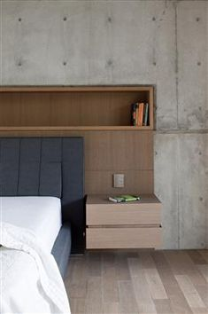 Nice, simple headboard design with storage.